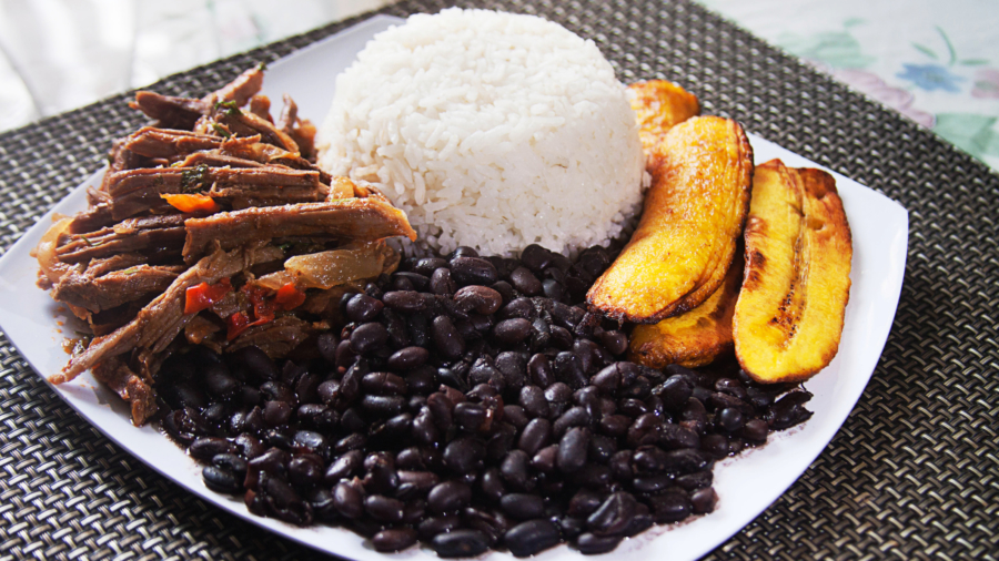 Venezuelan food. Pabellon Criollo. White Rice, Black beans,Fried plantains, and Shredded beef